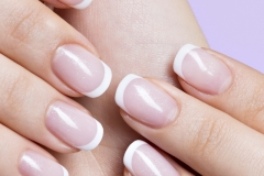 woman's nails with beautiful french white manicure
